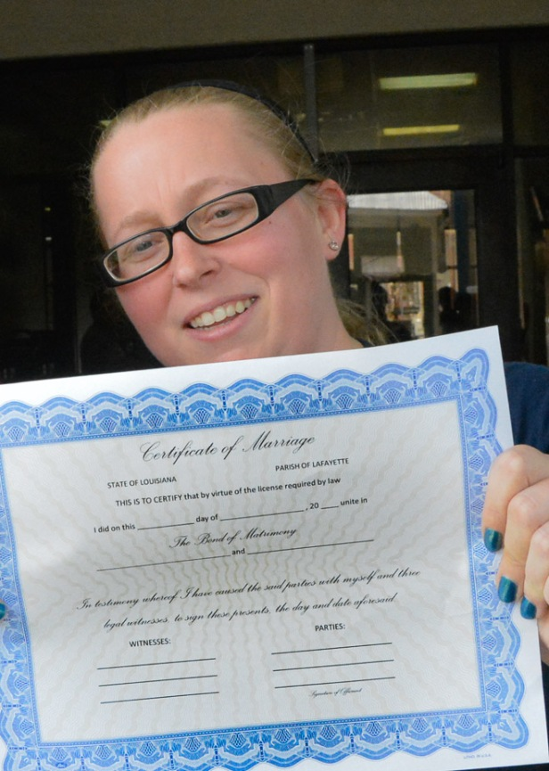 Chelsea Hughes displays her marriage license