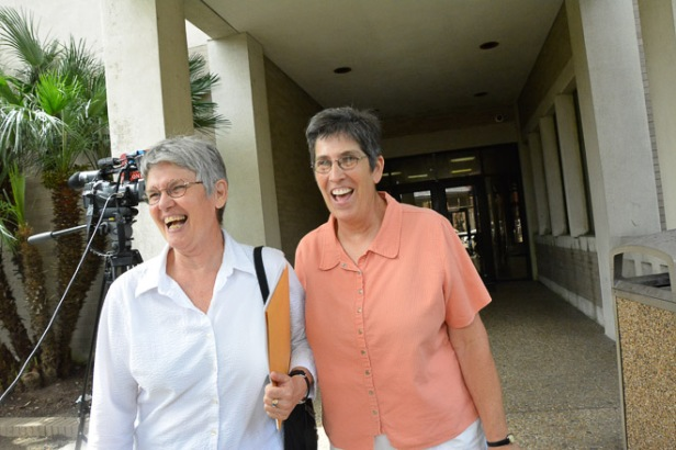 Catherine Cox and Mary Speyrer exit the Lafayette Parish Courthouse with a completed marriage license