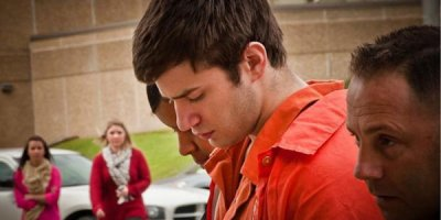 Seth Fontenot is escorted to the Lafayette Parish Courthouse.