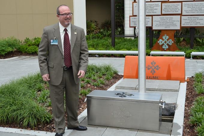 LGMC CEO Patrick Gandy prepares to bury the time capsule.